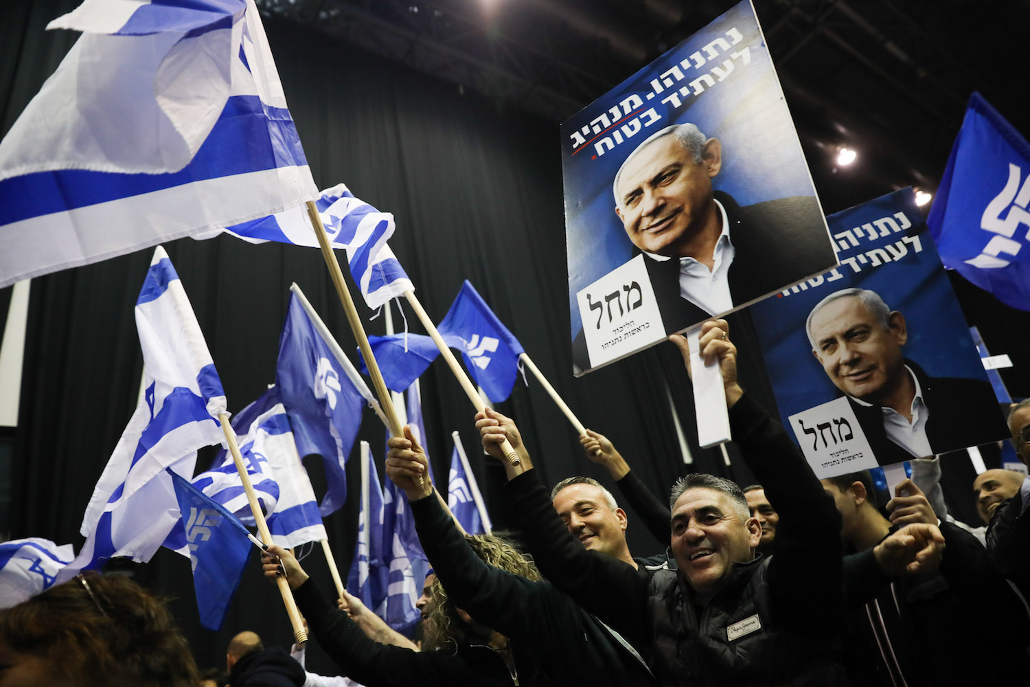 Likud supporters react to the results of the exit polls at Likud headquarters on election night in Tel Aviv, March 2, 2020. (Olivier Fitoussi/Flash90)