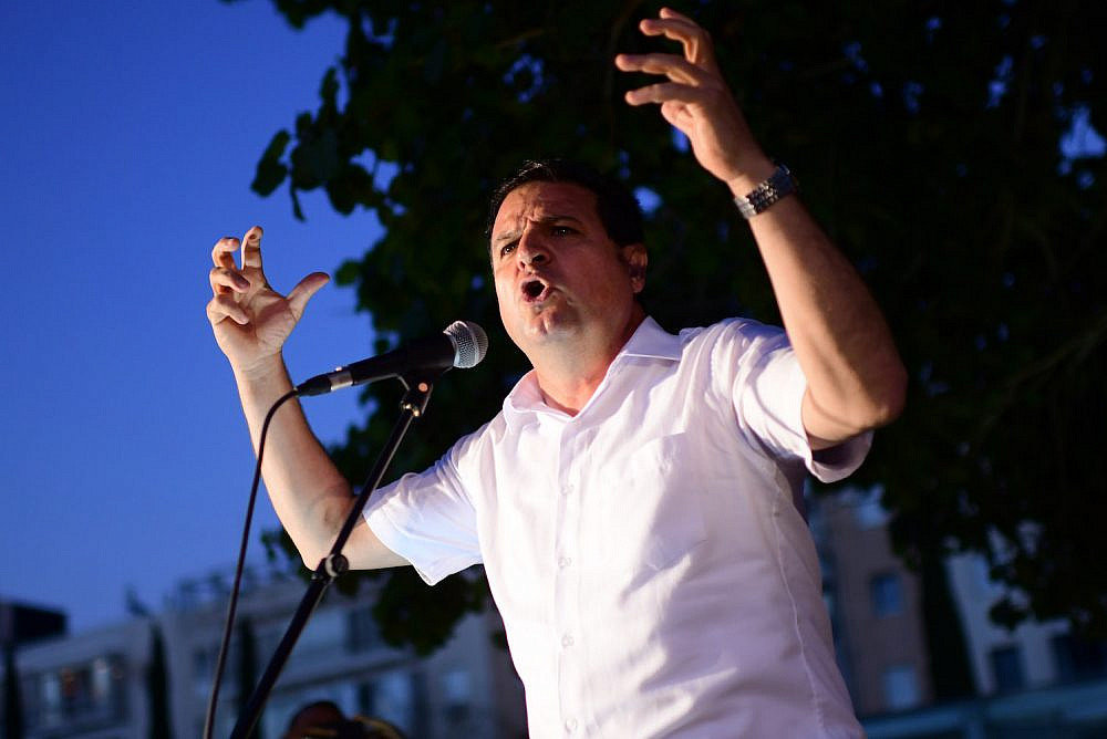 Leader of the Joint List Ayman Odeh seen during a protest for coexistence in Tel Aviv, May 15, 2021. (Tomer Neuberg/Flash90)