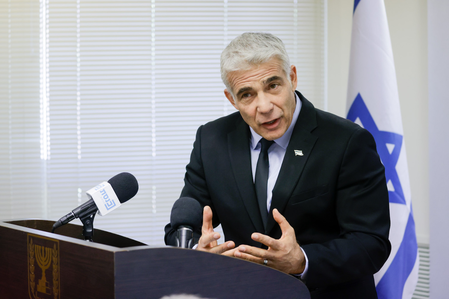 Foreign Minister Yair Lapid speaks during a Yesh Atid party meeting at the Knesset, Jerusalem, June 21, 2021. (Olivier Fitoussi/Flash90)