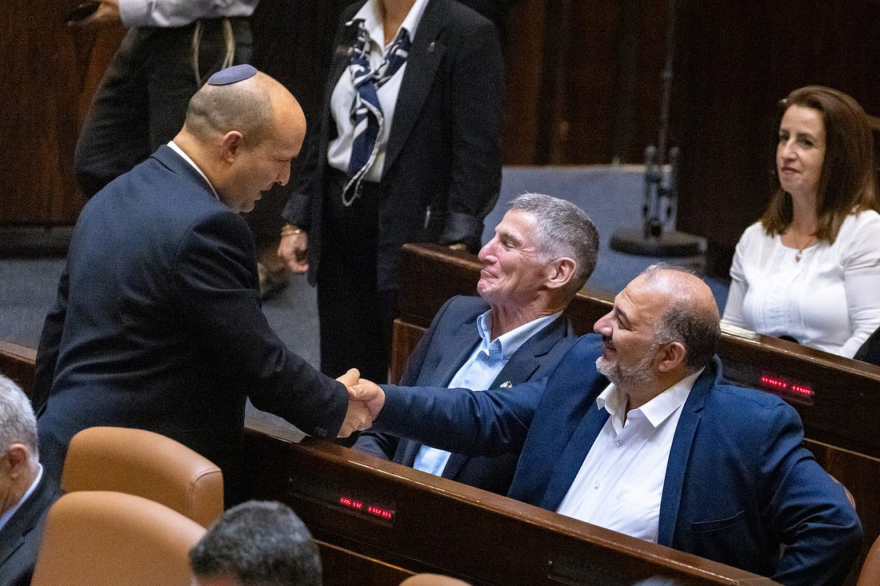 Prime Minister Naftali Bennet with with head of the Ra'am party Mansour Abbas in the assembly hall of the Israeli parliament on June 21, 2021. (Olivier Fitoussi/Flash90)