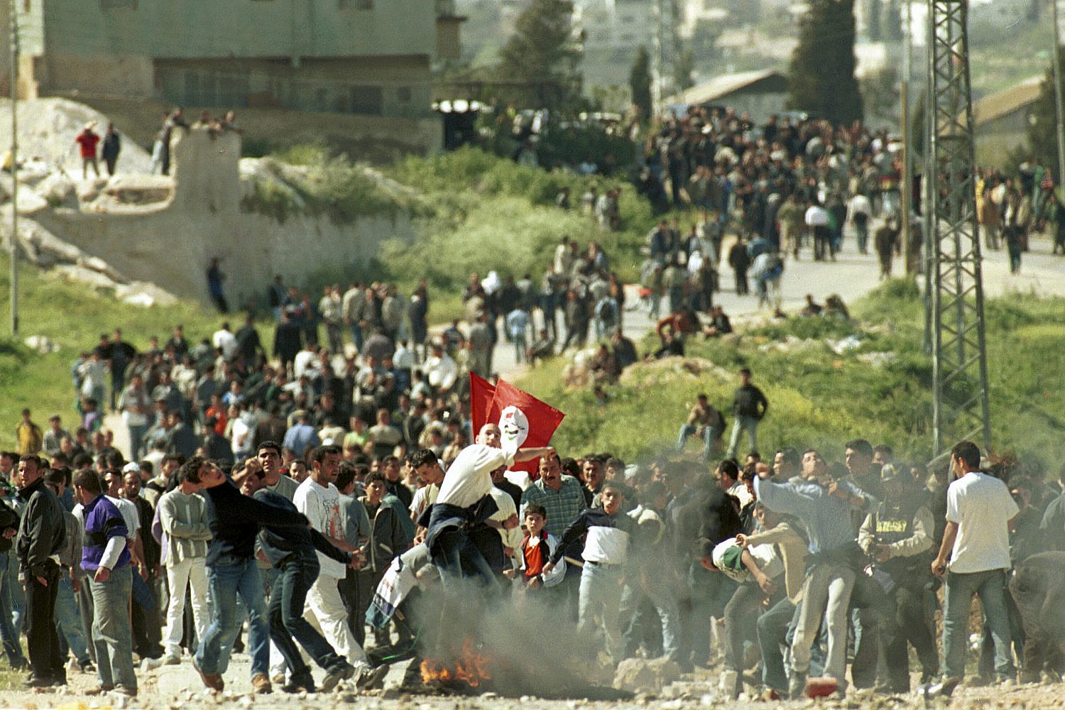 Palestinians throw rocks at a demonstration during the Second Intifada, March 25, 2001. (Nati Shohat/Flash90)