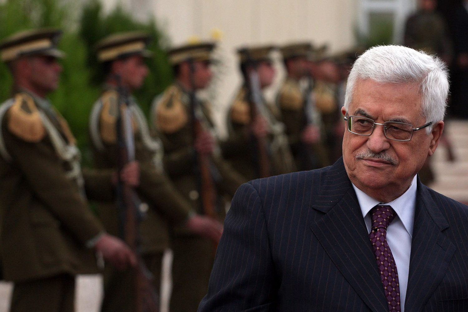 Palestinian President Mahmoud Abbas stands near the guard of honor outside his office in the West Bank city of Ramallah, Jan. 12, 2010. (Issam Rimawi/Flash90)