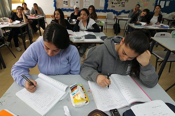 Illustrative photo of students completing assignments in a classroom. (Nati Shohat/Flash90)