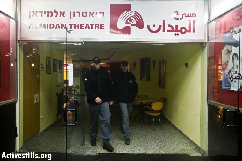 Police officers walk out of Al-Midan Theater in Haifa, after Israeli Police Commissioner Dudi Cohen ordered to call off a memorial event to PFLP leader George Habash. Feb. 1, 2009. (Oren Ziv/Activestills)