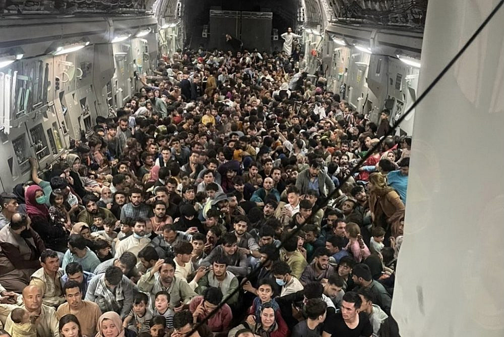 A U.S. Air Force plane transports hundreds of Afghan citizens from Hamid Karzai International Airport following the Taliban's takeover of the city, August 15, 2021. (Courtesy of the U.S. Air Force)
