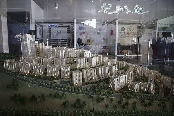 A model of the new Palestinian city of Rawabi is displayed at the center of the Rawabi project site, Feb. 23, 2014. (Hadas Parush/Flash90)