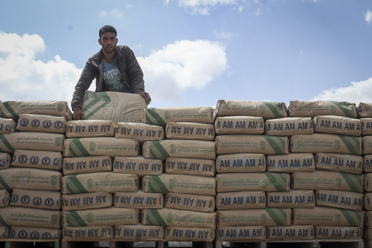 A Palestinian truck loaded with bags of cement after it entered the southern Gaza Strip from Israel through the Kerem Shalom crossing in Rafah, on May 23, 2016. (Abed Rahim Khatib/Flash90)