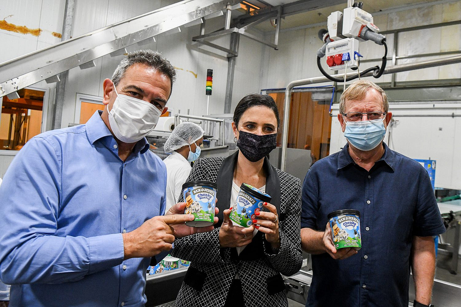 Israeli Interior Minister Ayelet Shaked tours the Ben and Jerry's factory near Kiryat Malakhi, with the CEO of the company's Israel distributor Avi Zinger (r), July 21, 2021. (Flash90)