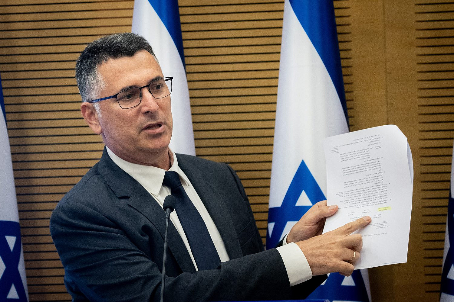 Head of the New Hope party Gideon Saar leads a faction meeting at the Knesset in Jerusalem, July 26, 2021. (Yonatan Sindel/Flash90)