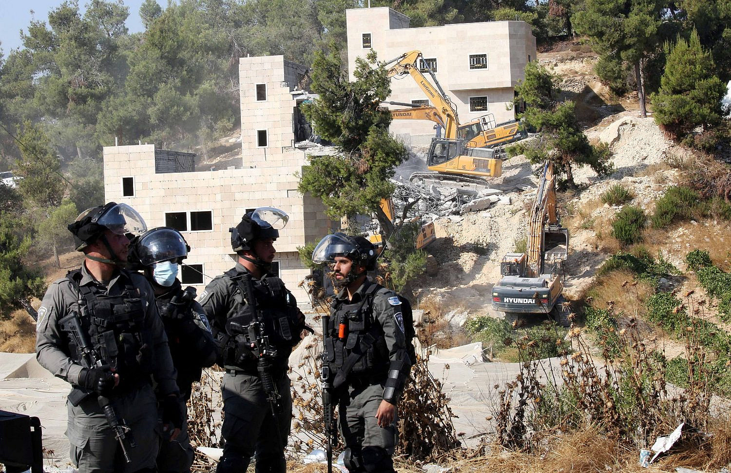 Israeli security forces demolish Palestinian houses in the village of Sair, near the West Bank city of Hebron, August 5, 2020. (Wisam Hashlamoun/Flash90)