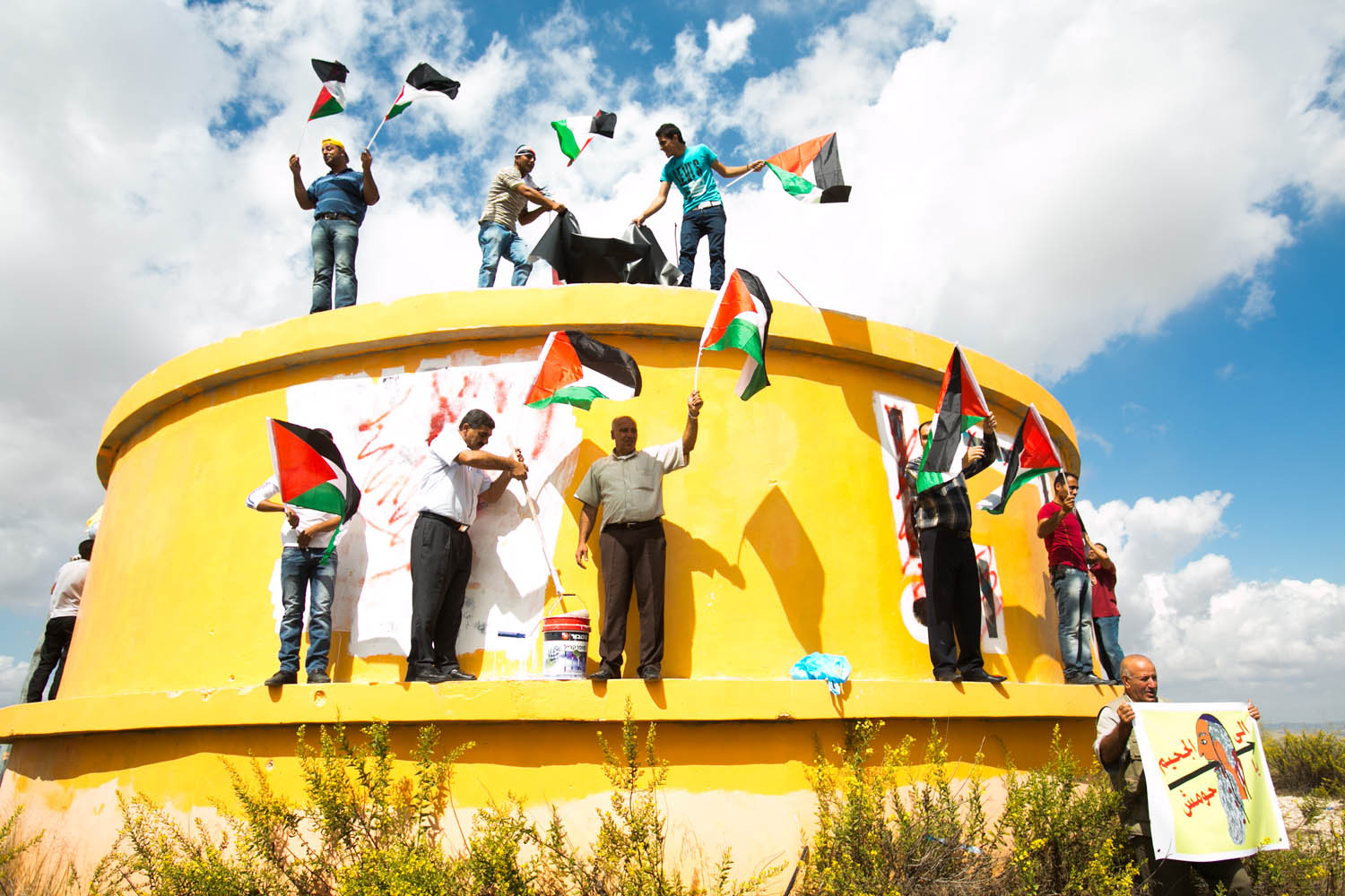 Illustrative photo of Palestinians holding a protest on the ruins of the evacuated settlement of Homesh in 2013. (Activestills.org)