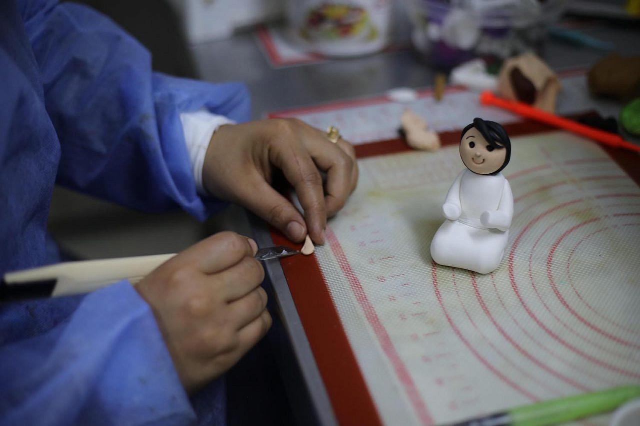 A bakers designs a sugar figure at Flavor Cake, Gaza City, September 2, 2021. (Mohammed Zaanoun)