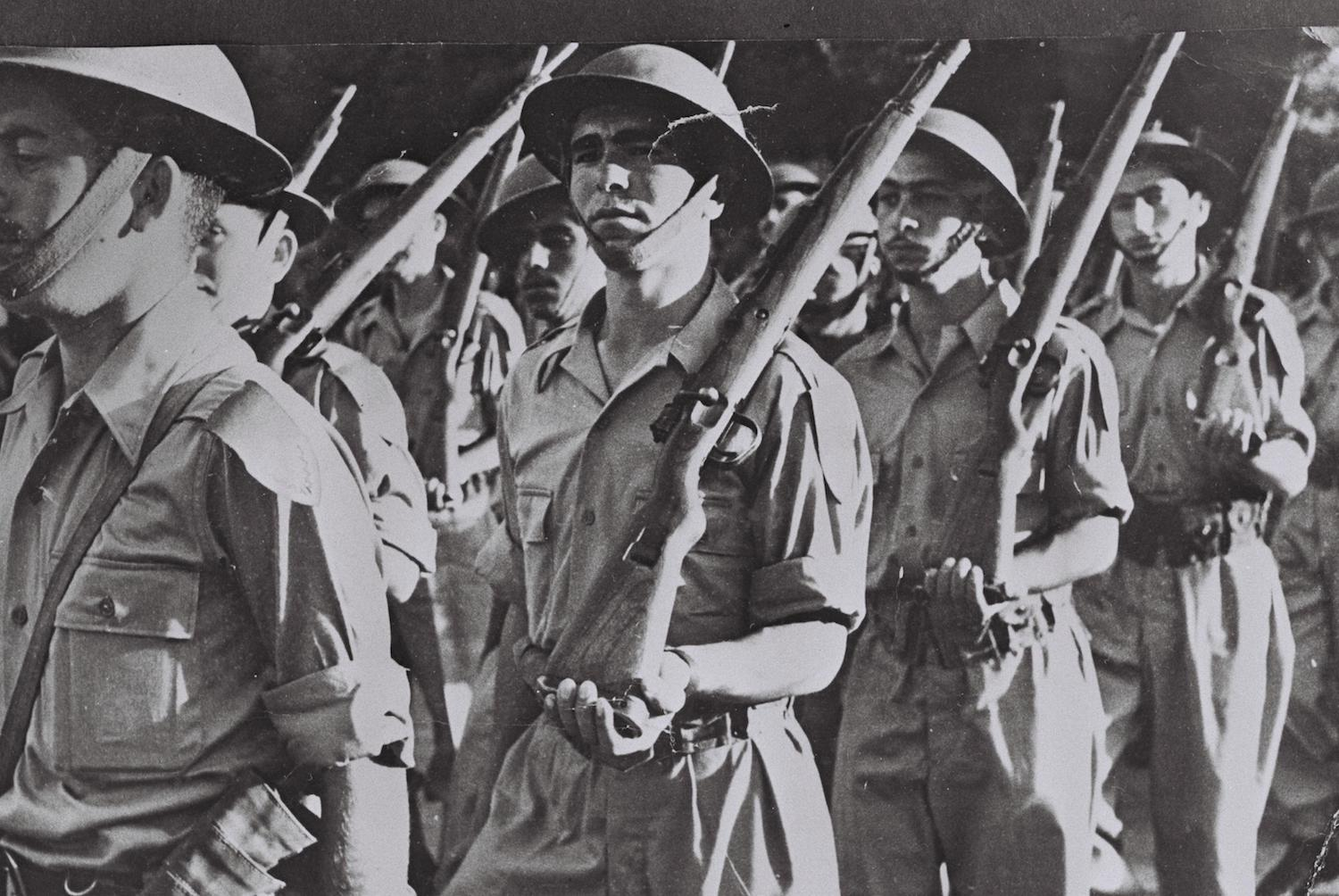An IDF infantry unit marches during a military parade marking Israel's first Independence Day, May 5, 1949. (Hugo Mendelson)