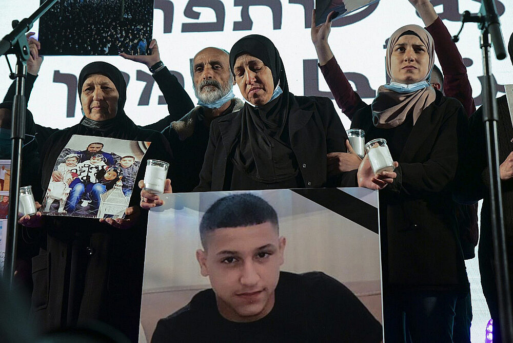 Palestinian and Jewish citizens of Israel protest in Tel Aviv against police inaction and surging crime and violence in Arab communities, March 13, 2021. (Flash90)