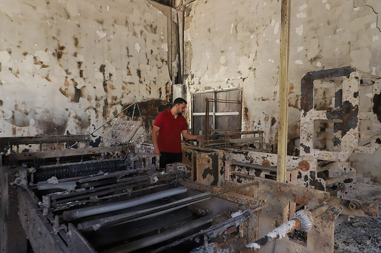 Ahmed Abu Eskander inspecting the damage to his plastics factory after Israel's latest assault on Gaza. (Courtesy of Fidaa Shurrab)