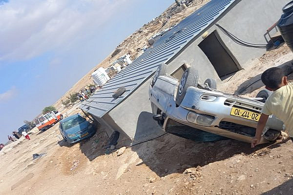 A car seen overturned during a settler attack on the Palestinian village of Mufagara in the South Hebron Hills. Sixty masked settlers attacked people, homes, and cars, September 28, 2021. (Alliance for Human Rights)