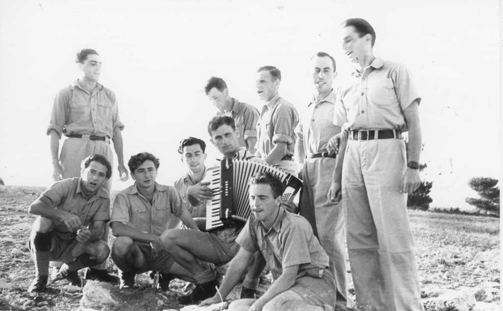 Soldiers in the Palmach, the elite fighting force of the Haganah, play music during military training, in the northern town of Beit Oren, circa 1941. (The Palmach Archive)