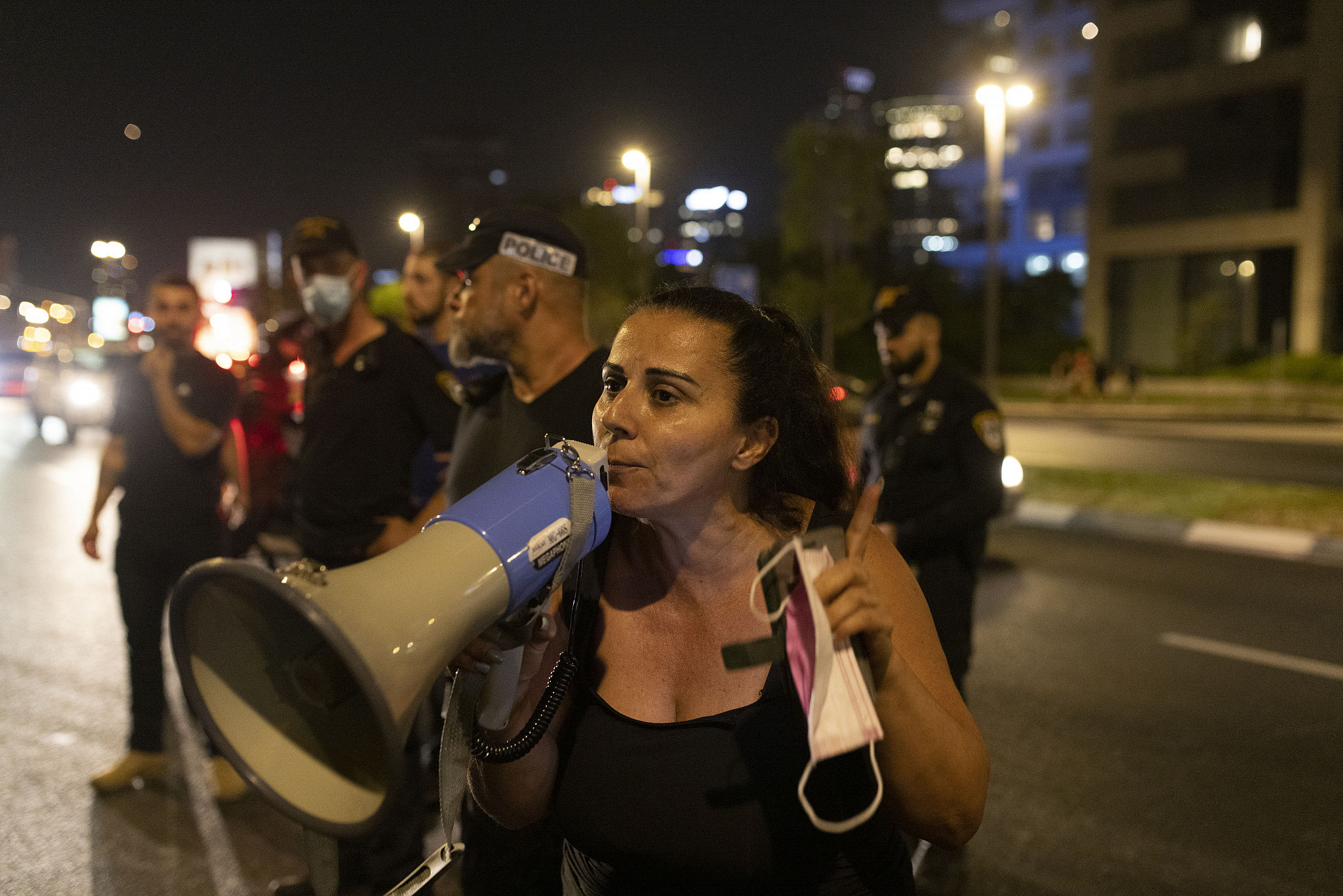 Mali Alfasy-Fihamin leads a demonstration in north Tel Aviv against the eviction and forced displacement of the residents of Givat Amal, August 1, 2021. (Oren Ziv)