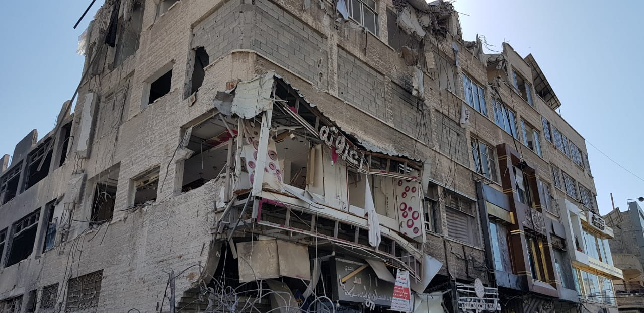 Yehiya Abu Jabal's Zaghrouta dress shop on Gaza City's Remal Street, seen destroyed after Israel bombed a high-rise building in the area. (Courtesy of Fidaa Shurrab)