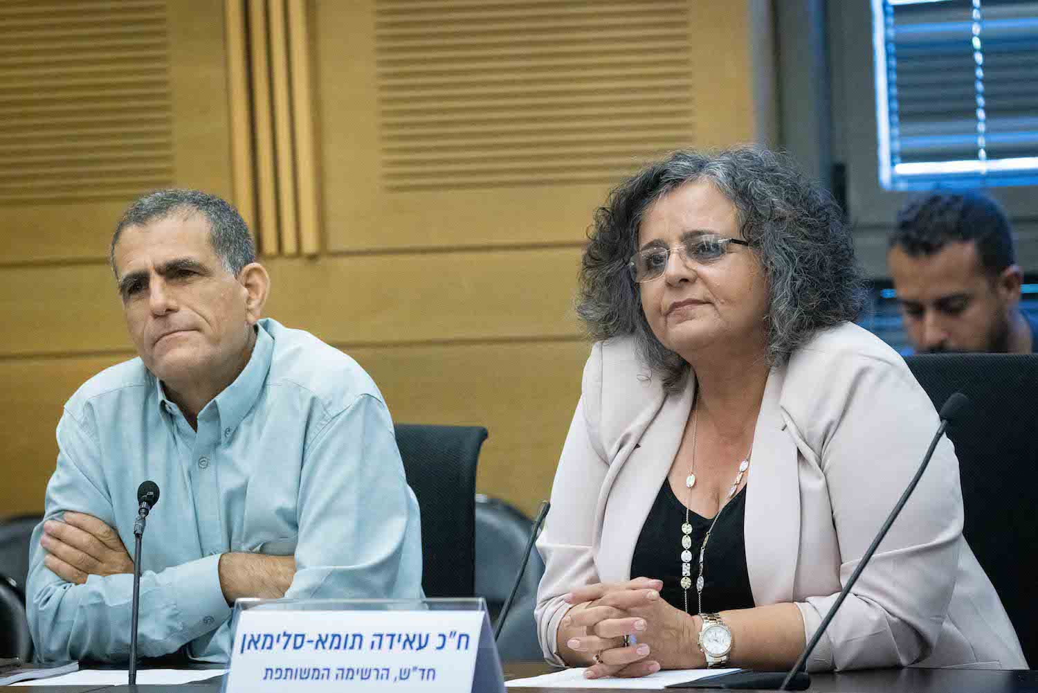 """Members of Mossi Raz (left) and Aida Touma-Suleiman (right) attend an event titled """"Between Occupation and Apartheid"""" in the Knesset, June 22, 2021. (Yonatan Sindel/Flash90)"""