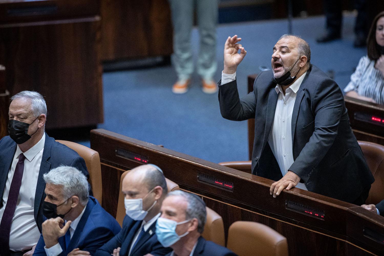 Ra'am Chairman Mansour Abbas seen during a Knesset plenum session, August 2, 2021. (Yonatan Sindel/Flash90)