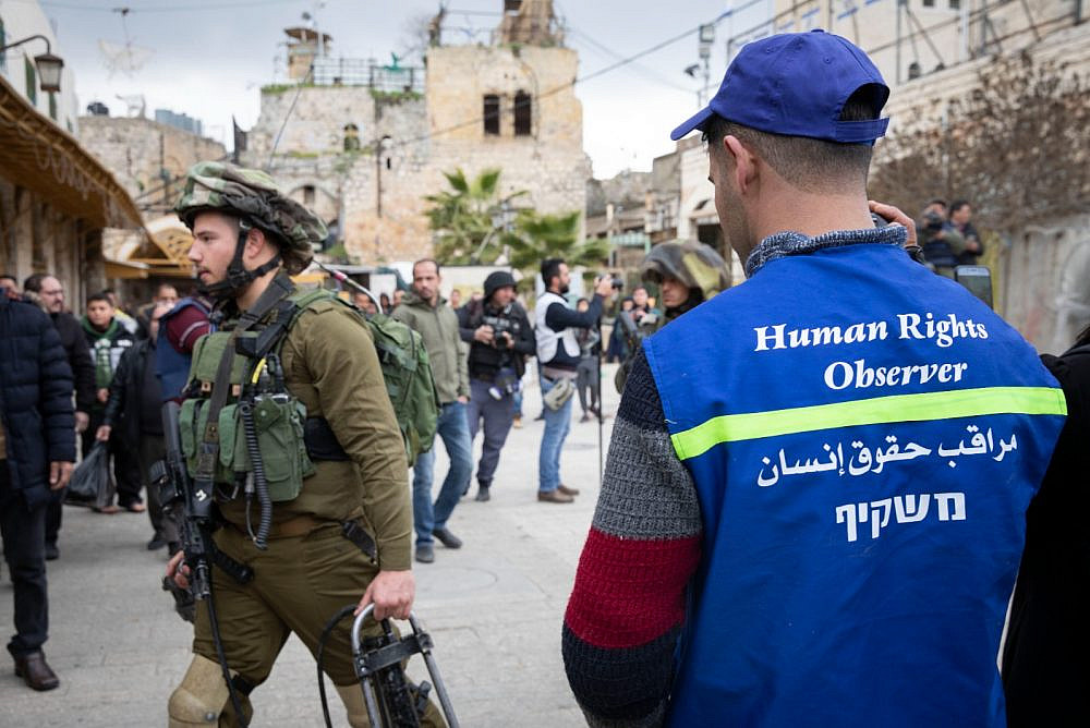 A member of the Temporary International Presence in Hebron (TIPH), a civilian observer mission in Hebron, seen in the West Bank city on January 28, 2019. That year, the Israeli government refused to renew TIPH's mandate, effectively removed the force from the city. (Catherine Curran-Groome)