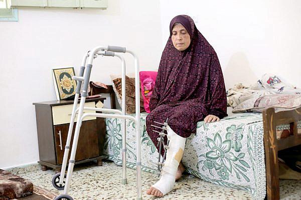 Muna Aman, who lost her husband and three daughters to an Israeli air strike. (B'Tselem)